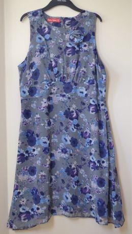 Letnia rozkloszowana sukienka w fioletowe i niebieskie kwiatki 44