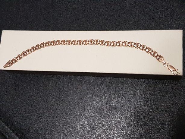 Sprzedam złotą bransoletkę próby 585 z czerwonego złota. Stan idealny.