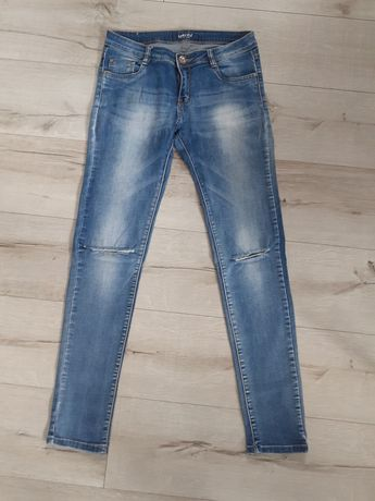 Spodnie jeansy rurki z dziurami r36-38