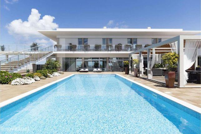 Moradia de luxo frente ao mar, no Resort Praia d'El Rey - ambiente de
