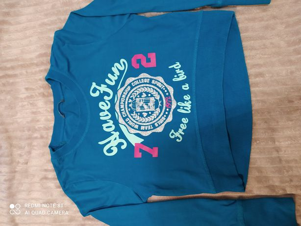 Krótka bluza firmy Lindex rozm. 146/152
