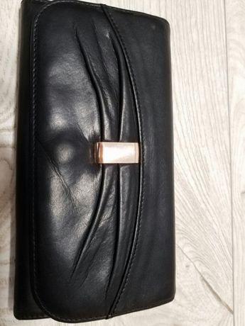 Кожаный кошелек .