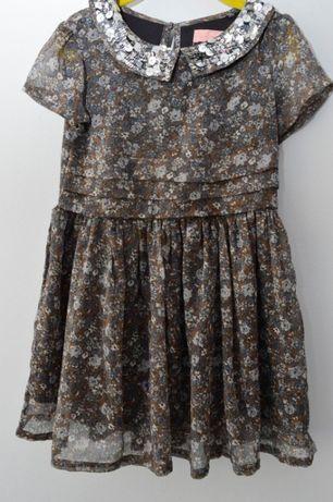 Przepiękna sukienka z błyszczącym kołnierzykiem