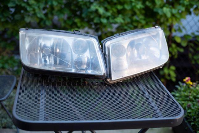 Lampy HELLA z silniczkami VW BORA GOLF 1999r komplet
