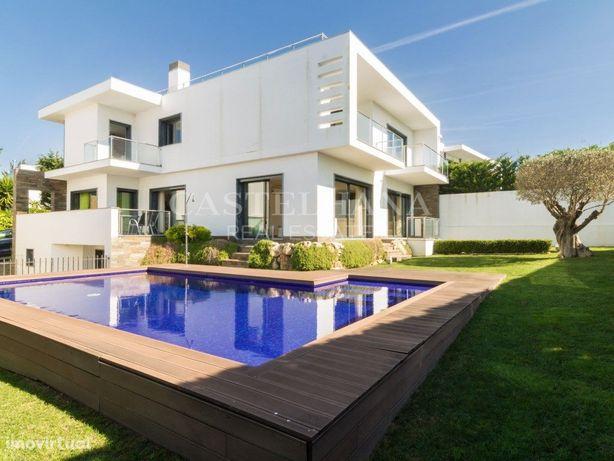 Excelente moradia com piscina, jardim e vista mar no Estoril