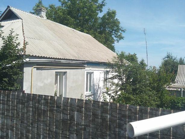 Продам пів будинка місто Канів.
