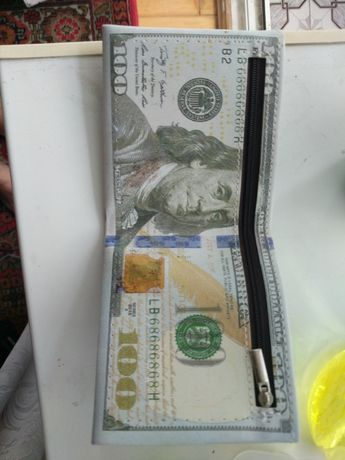 Віддам Гаманець 100$$