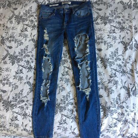 Spodnie z dziurami przecierane jeansy s 36 Zara hm