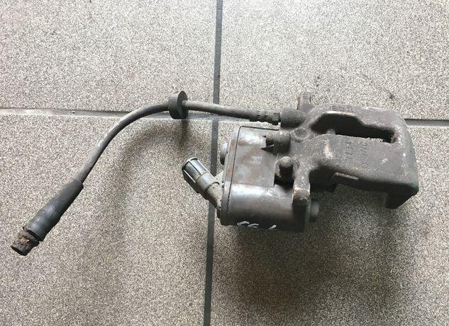 Zacisk lewy tył 302 mm elektryczny 2.0 Tdi Audi A6 C6