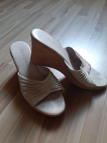 Buty skórzane na koturnie od Ryłko