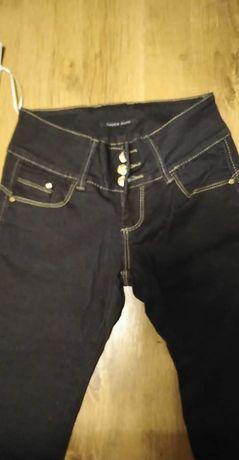 Nowe spodnie jeansy rozmiar 25
