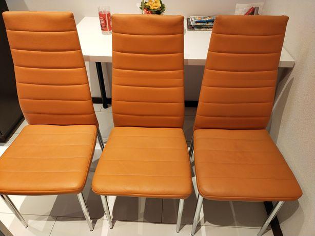 Krzesla.Dwie sztuki.Kolor pomarańczowy.