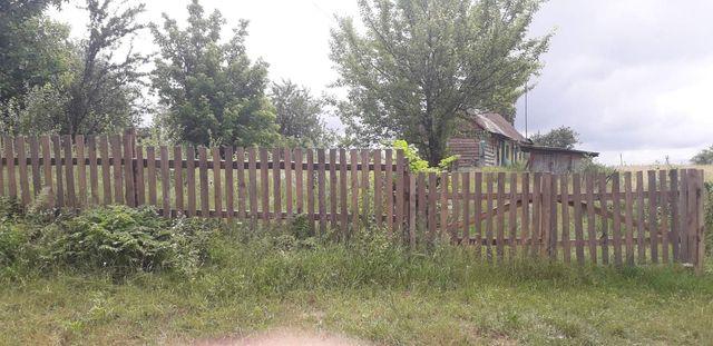 Продам земельну ділянку з будинком.