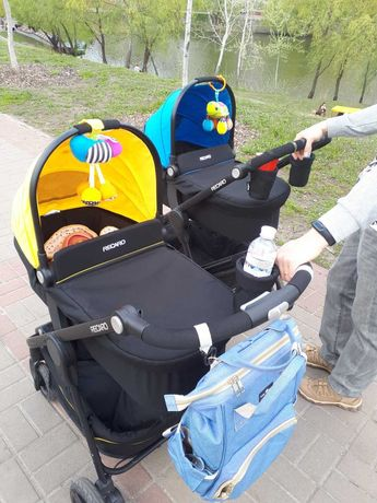 Желтая коляска Recaro Citylife (2 в 1) + спальний мешок Britax