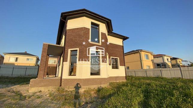 Продается новый кирпичный дом под отделку Гатное