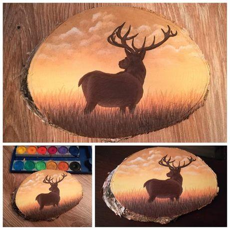 Obraz jelenia na plastrze drewna