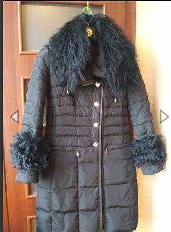 Пальто пуховик состояние нового
