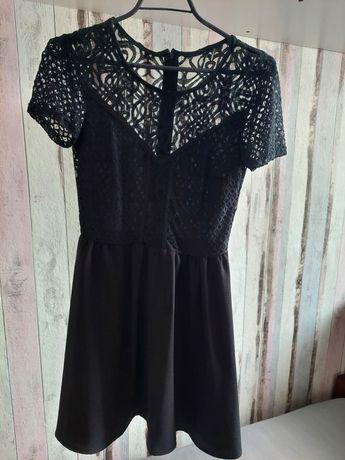Rozkloszowana sukienka H&M z elementami koronki XS