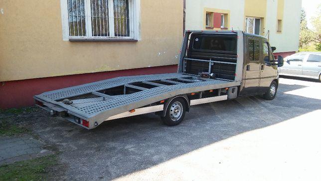Autolaweta Transport Pomoc drogowa Holowanie Auto laweta