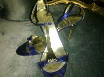 Sapatos de luxo exclusivos como novos