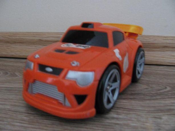 Samochód Fisher-Price -na baterie(warkocze i sam jeździ)