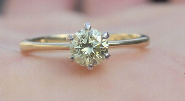 Złoty pierścionek, Brylant 0.62ct K/SI1 Zamiana