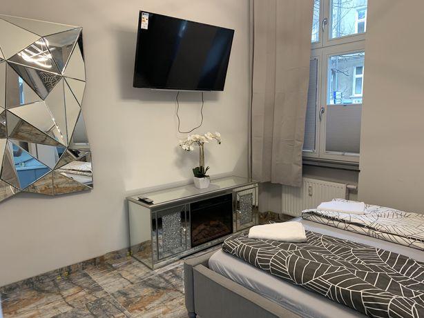 Luksusowy apartament kominek noclegi doby godziny Poznań PKP MTP