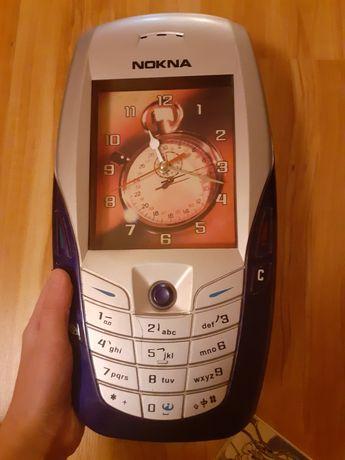 Zegar ścienny w kształcie telefonu
