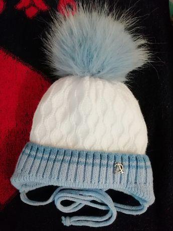 Продам зимнюю шапку для новорожденны