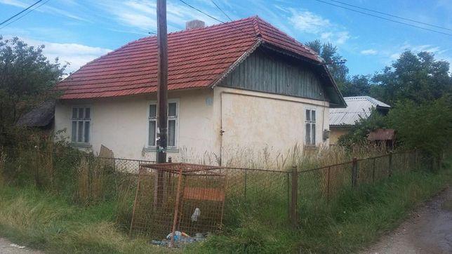 Продам земельну ділянку 15 сотих з будинком