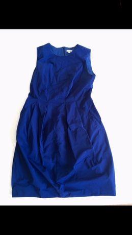 Niebieska sukienka Solar rozkloszowana z kieszonkami na ramiączkach