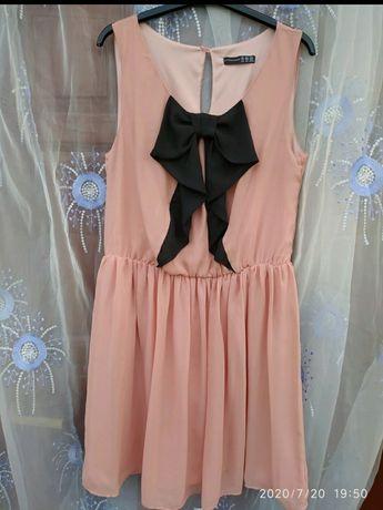 Lekka sukienka z kokardą