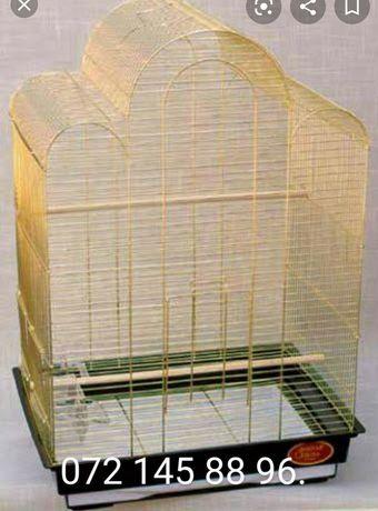Клетка золотая для крупных птиц.