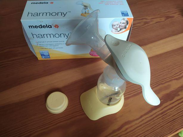 Laktator ręczny Medela + butelka