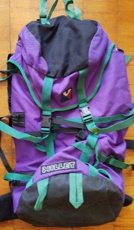 Фиолетовый рюкзак Millet около 60 литров с жесткой спинкой и поясом