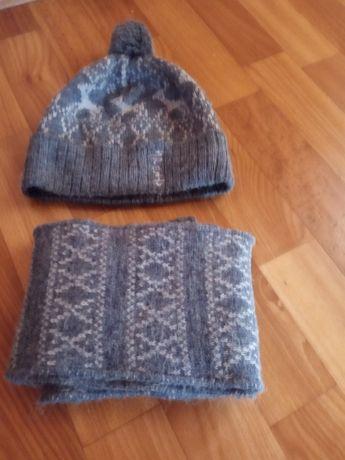 Продам зимнюю  шапку на мальчика 6-8 лет
