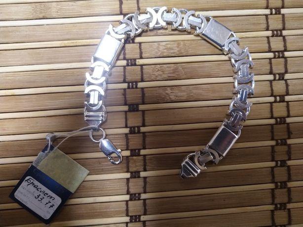 Срібний браслет широкого плетіння .