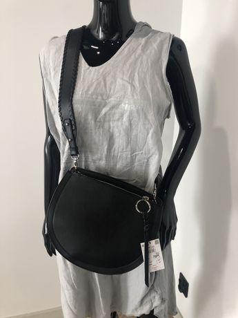 Torebka saddle bag wykonana z gładkiego materiału imitującego skórę