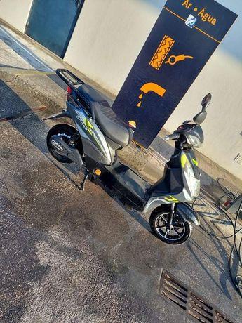 Vendo mota elétrica como nova tei cargador fatura faz 60 kh anda 45 p