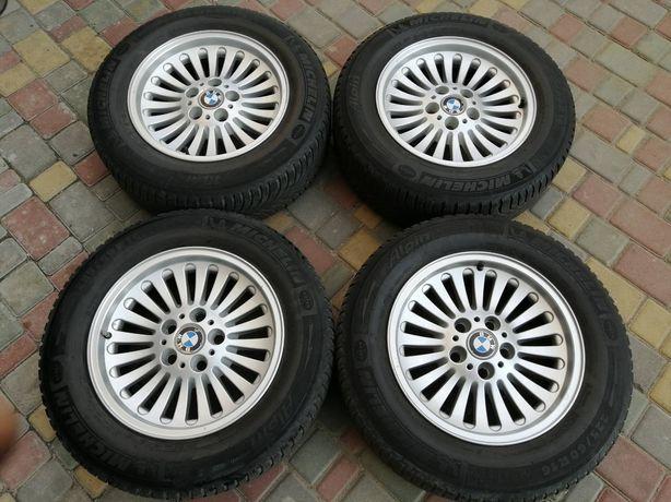 Продам комплект оригинальных литых дисков R16 от BMW с зимней резиной.