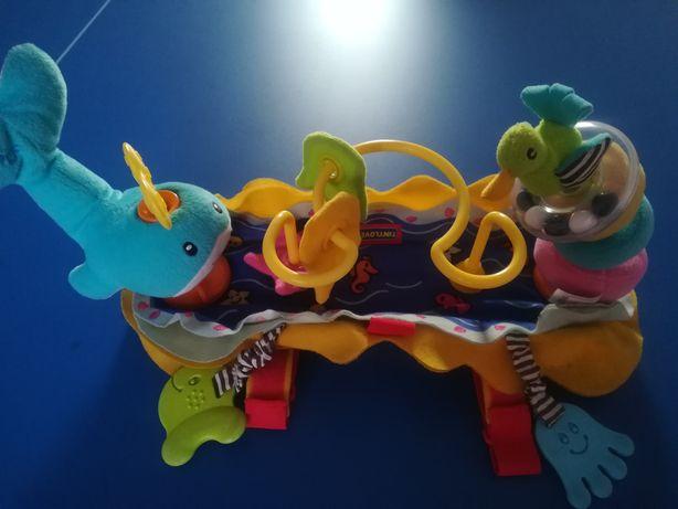 Zabawka TinyLove do spacerówki z uchwytem na butelkę