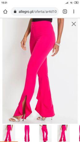 Eleganckie spodnie z falbanami 44 xxl
