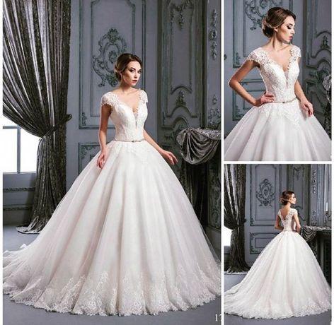 Шикарное свадебное платье с шлейфом