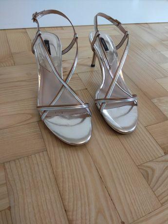 Złote - srebrne eleganckie sandały. Rozm. 38