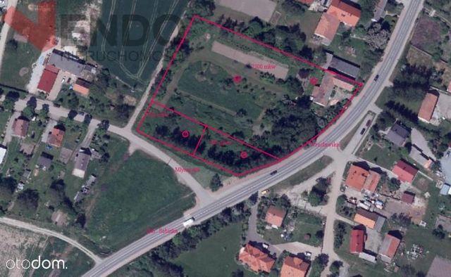 Grunt pod zabudowę wielorodzinną, 9100 m2 z domem