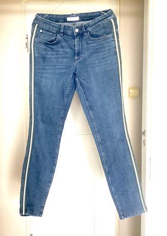 Super modne w tym sezonie spodnie dżinsowe z lampasem Tchibo 38