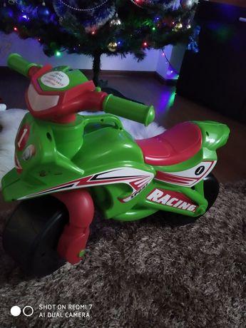 Іграшки Толкатор мотоцикл мизикальний