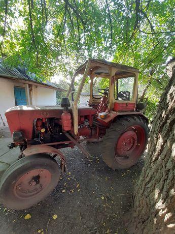 Трактор т 25. ХТЗ. С культиватором, плугом и лопатой