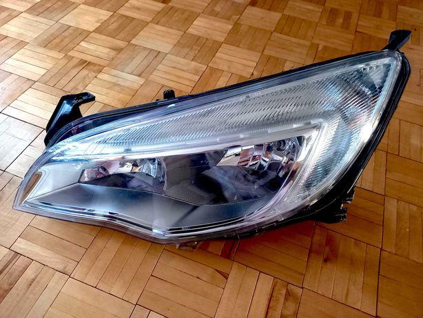 Lampa Opel Astra J IV HELLA reflektor LEWY lewa kierowcy ORYGINAŁ