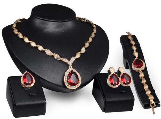 """""""Swarovski""""- złote (14k) komplety z dorodnymi szafirami lub rubinami;"""